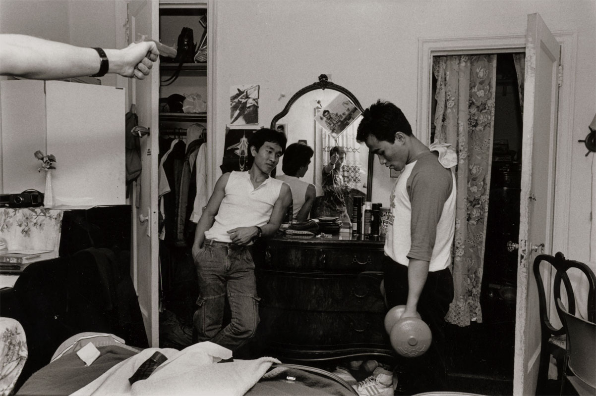 Young Cambodian men in bedroom