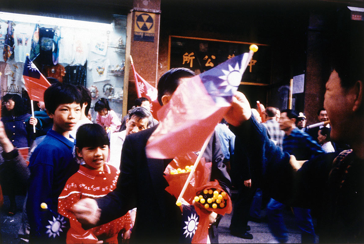 Handing Out Flags on the 80th Anniversary of the First Revolution